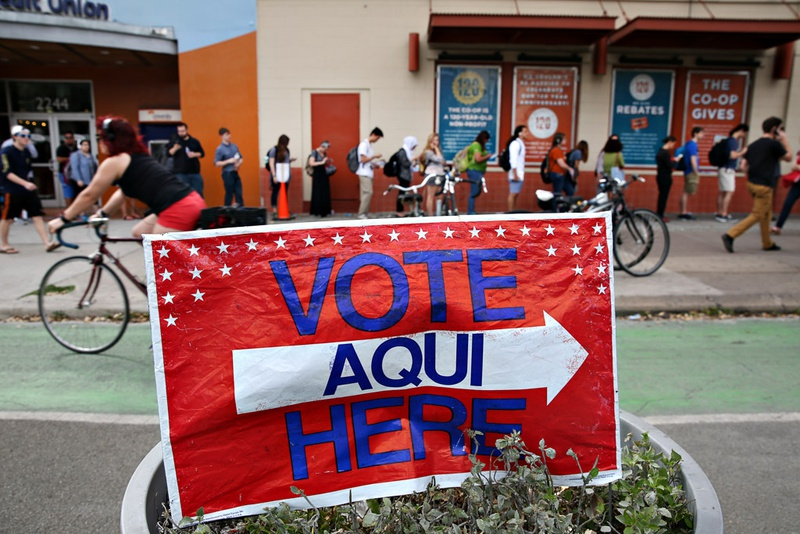 Voters wait in line at the University of Texas Co-op to cast their ballots in the March 1, 2016 primary elections.