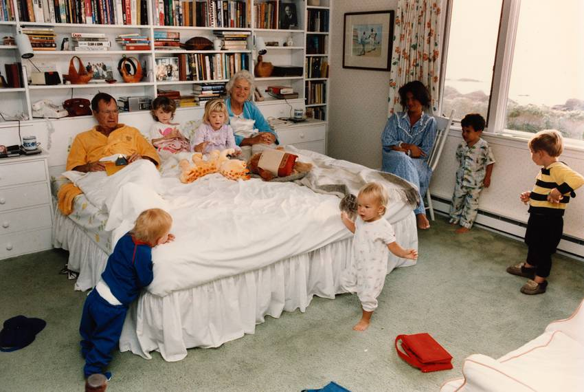 Vice President George H. W. Bush and Barbara Bush visit with their grandchildren in the bedroom of their home in Kennebunk...