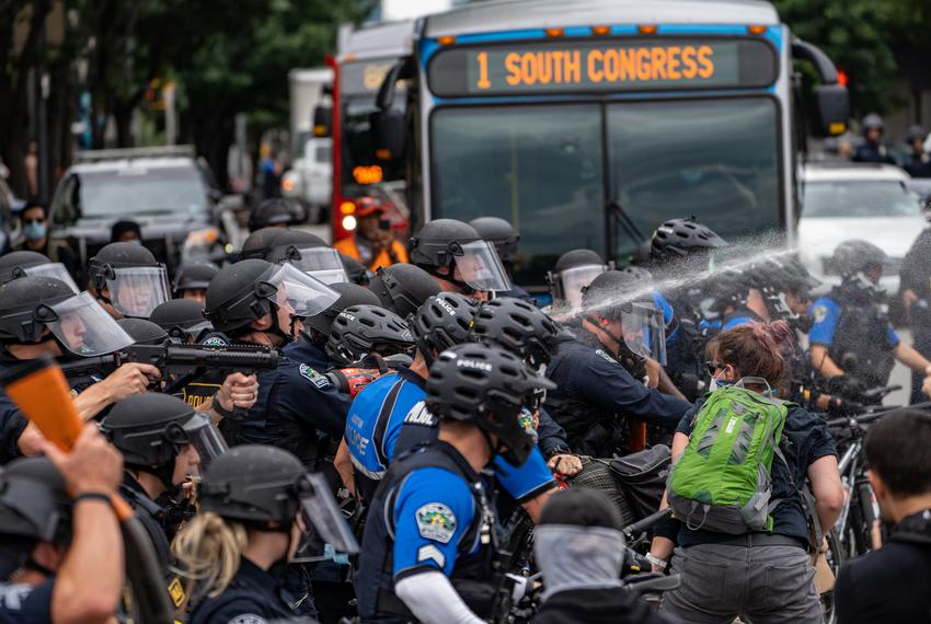 Police fire tear gas and rubber bullets at several demonstrators in Austin on May 31, 2020.