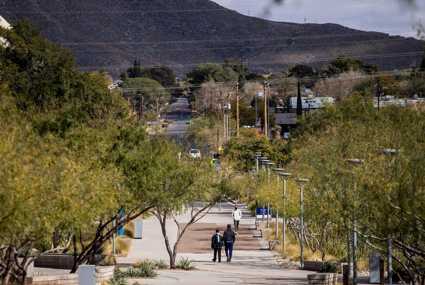 People walk on campus at the University of Texas at El Paso on Dec. 2, 2020.