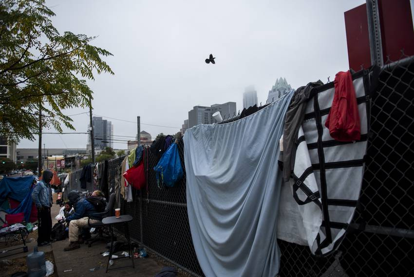Communal clothes are hung to dry on a fence across the Austin Resource Center for the Homeless this week.