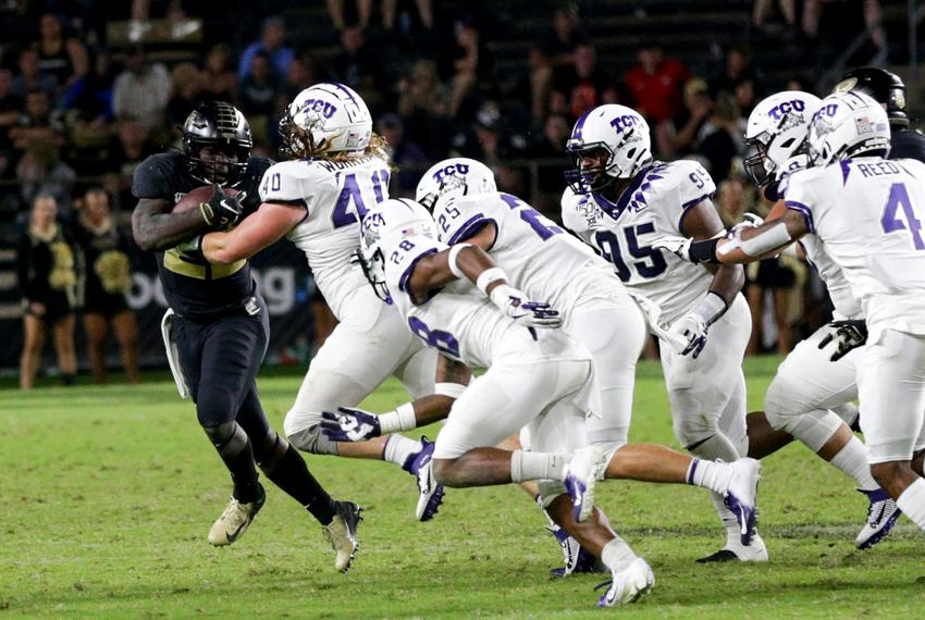 Purdue running back King Doerue runs the ball against the Texas Christian University defense during a NCAA football game o...