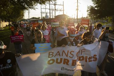 Women's rights activists march through downtown Brownsville in response to the anti-abortion legislation passes, on Oct. 2, 2021