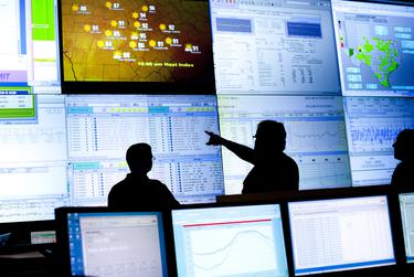 Reliability Coordinators monitored the state power grid during a tour of the Electric Reliability Council of Texas (ERCOT) command center in Taylor in 2012.