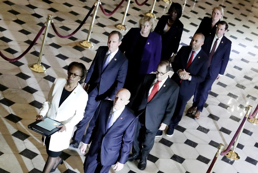 U.S. House of Representatives Clerk Cheryl Johnson and House Sergeant at Arms Paul Irving carry two articles of impeachment …