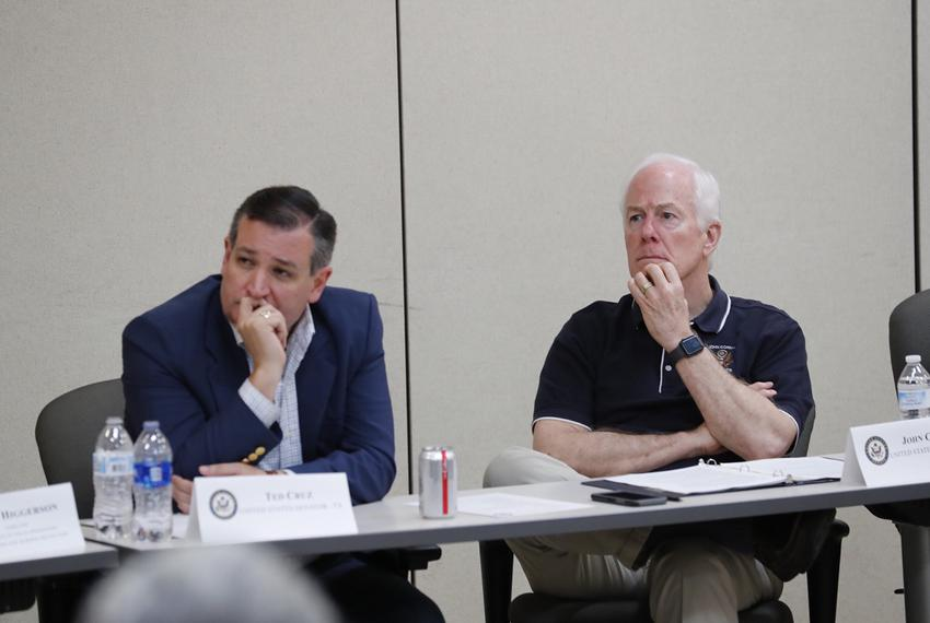U.S. Sens. Ted Cruz (left) and John Cornyn listen at a a roundtable discussion at a South Texas border patrol station in Wes…
