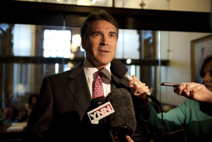 Gov. Rick Perry speaks to the press after leaving a school finance meeting between leaders in the House and Senate May 27, 2…