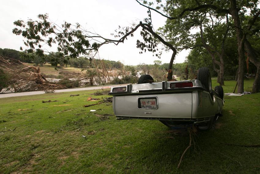 An overturned vehicle on the banks of the Blanco River on May 26, 2015. The area saw record-breaking flood levels two days b…