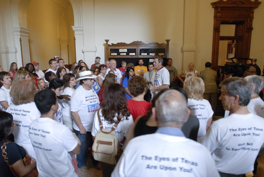 Texas teachers from Save Texas Schools crowd the hallway outside the House chamber protesting budget cuts on Saturday, May 2…