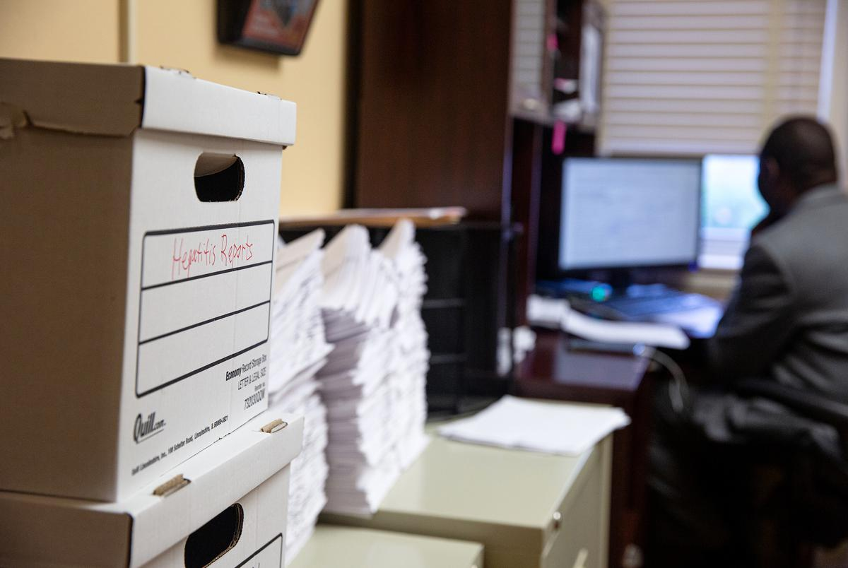 A box of hepatitis reports sit among stacks of information regarding all sorts of diseases at the Northeast Texas Public Health District office in Tyler.