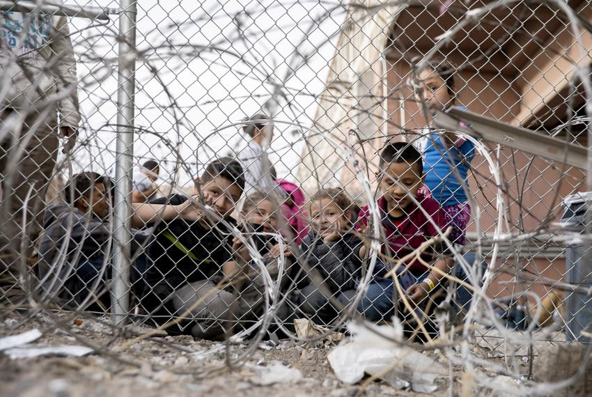 A group of kids are seen inside a temporary migrant holding area set up by Customs and Border Protection under the Paso del …