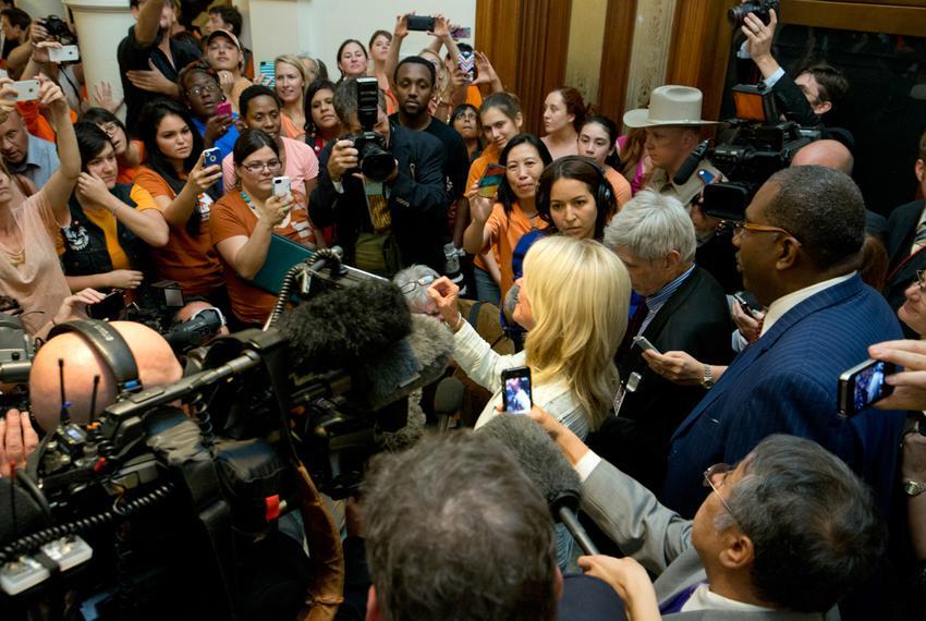 Crowds gather outside the Senate hallway to hear State Sen. Wendy Davis after the midnight drama that killed abortion legisl…