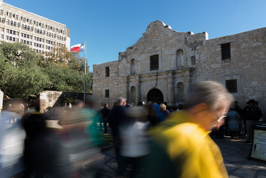 Tourists crowd the entrance of the Alamo in San Antonio on Dec. 3, 2015.
