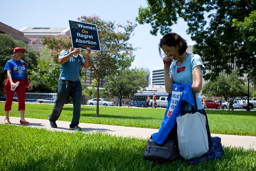 Anti-abortion activists on the Texas Capitol lawn on the first day of the second special session of the Legislature, July ...