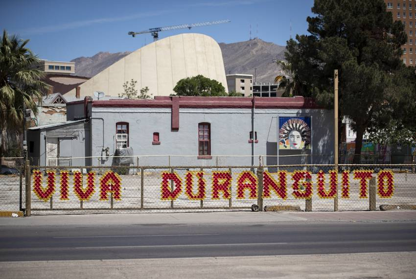 "A ""Viva Duranguito"" sign on a fence on the edge of the Duranguito neighborhood in El Paso in April."
