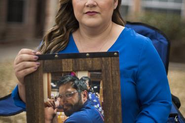 Valerie Villegas with a portrait of her late husband Robert Villegas at her home in Portland.  Robert died from COVID-19 on January 25, 2021.