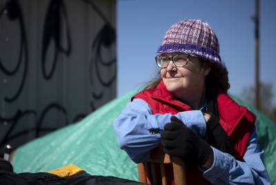 Susan Peake lives at the state-run homeless encampment off of U.S. Highway 183 in Austin. Feb 25, 2020.