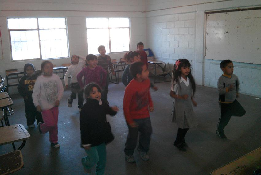 Children who participate in an after school program in Ciudad Juárez dance to Beyoncé as part of their routine. The program …
