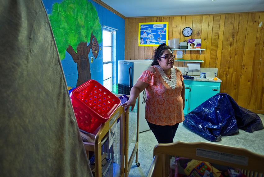 LaVeta Rodriguez, director of the Little Lights Learning Center stands among the unused cribs, toys and equipment in the bab…