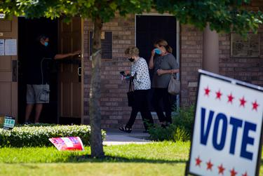 People enter a polling site at 7811 Rockwood Lane on Tuesday, July 14, 2020 in Austin.
