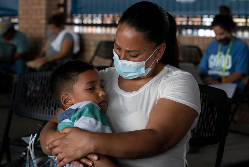 Venezuelan asylum seeker Jhinezka de Arias holds her son Cristhofer at the bus station in Brownsville, Texas, on Feb. 25.
