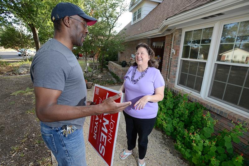 Mayoral candidate John James talks with Sarana Savage outside her Midland home on Sept. 15, 2013.