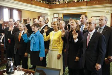 State senators take the oath of office on the first day of the Texas Legislature on Jan. 13, 2015.
