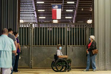 Voters wait in line to cast their ballot at the Dripping Springs Ranch Park polling site in Dripping Springs.
