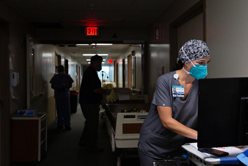 Nurse practitioner Cheryl Shovan inputs patients' data in the halls of the COVID-19 care unit at Titus Regional Medical Cent…