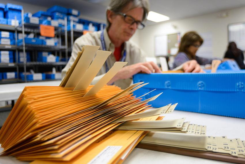 Ballot by mail clerk Jim Ragland organized ballot packages at the Travis County Elections Division in Austin in 2014.
