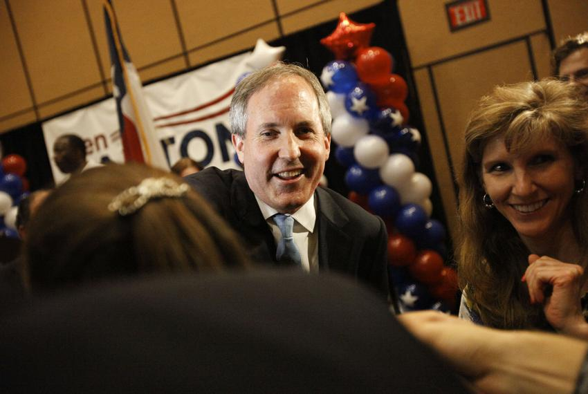 State Sen. Ken Paxton celebrated with supporters after winning the Republican primary runoff for Texas attorney general on M…