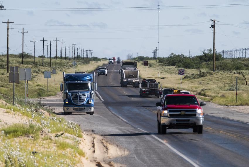 Early morning oilfield traffic moving southwest on Highway 115 toward Kermit, Texas.