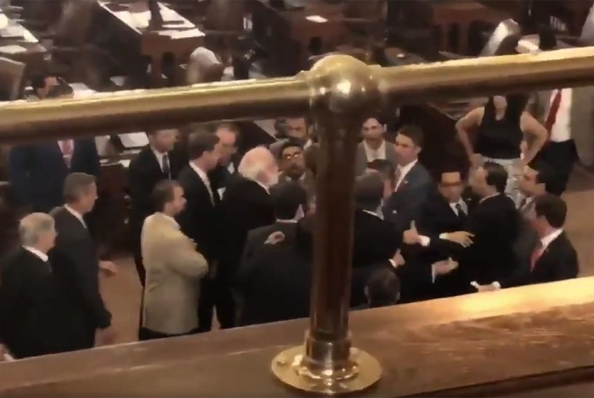 "Following a ""sanctuary cities"" ban protest in the gallery, lawmakers tussle on the House floor on May 29, 2017 — the last day of the 85th regular legislative session."