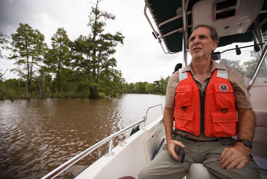 Professor Kirk Winemiller of the Texas A&M Department of Wildlife and Fisheries, on a bayou along the Neches River near Beau…
