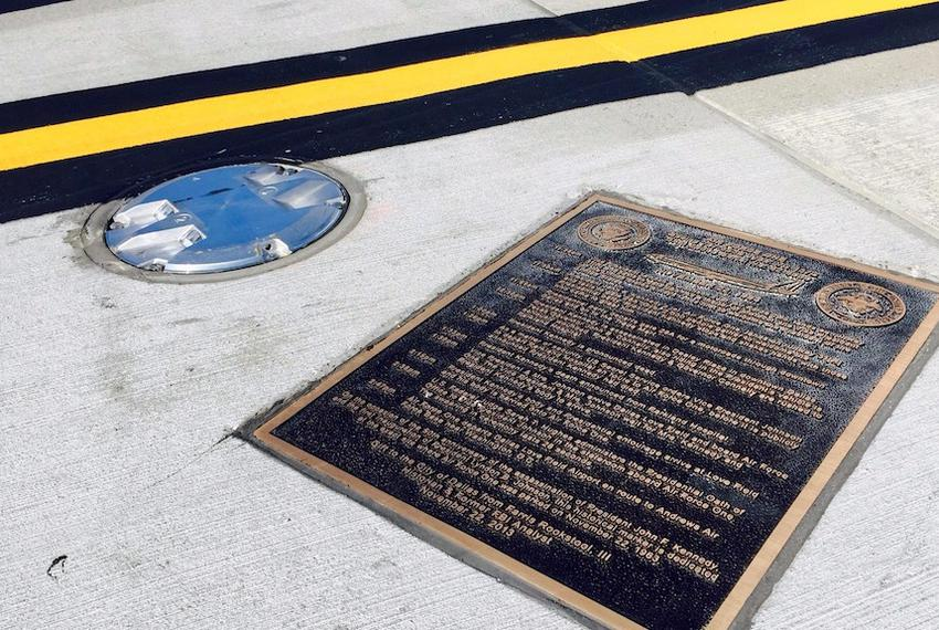 The bronze marker on a taxiway at Love Field, inaccessible to the public, which forever marks the spot where LBJ took the ...