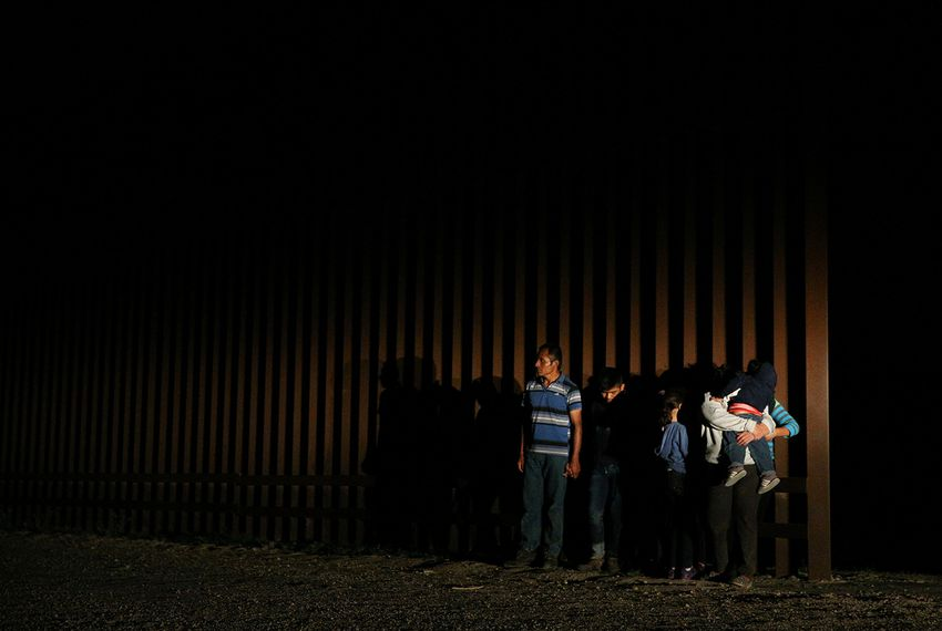 Immigrants who illegally crossed the Mexico-U.S. border are apprehended by the U.S. border patrol in the Rio Grande Valley sector, near McAllen, Texas, U.S., April 5, 2018.