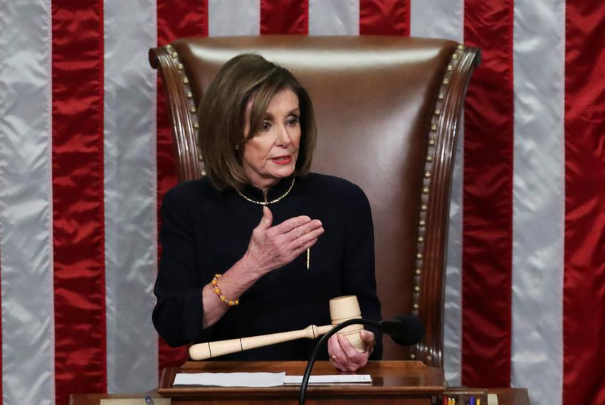 Speaker of the House Nancy Pelosi presides over the House of Representatives vote on a second article of impeachment against…