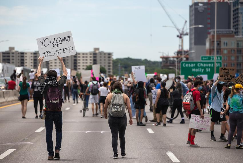 Hundreds of protesters met at the Austin Police Headquaerters in downtown Austin and proceeded to take over both sides of ...