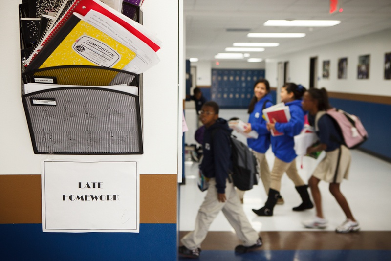 Students enter a classroom one one of the 11 Houston-area campuses of Yes Prep, a public charter school system serving 7,000 low-income students.