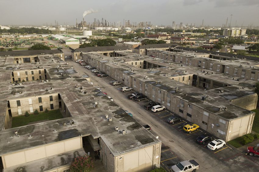 An old apartment complex within view of the ship channel refineries on the north side of Pasadena, Texas, July 1, 2017.