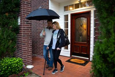 Flo Rice, a survivor of the Santa Fe High School shooting, leaves her house with husband, Scot Rice, for a physical therapy appointment.