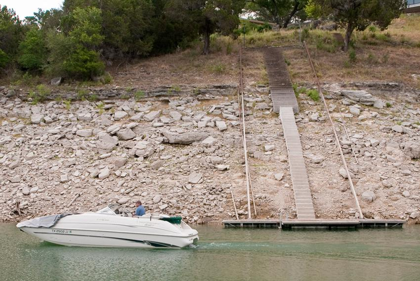 Residents of Lake Travis have extended staircases and moved docks further out to accommodate lower lake levels. Some say t...