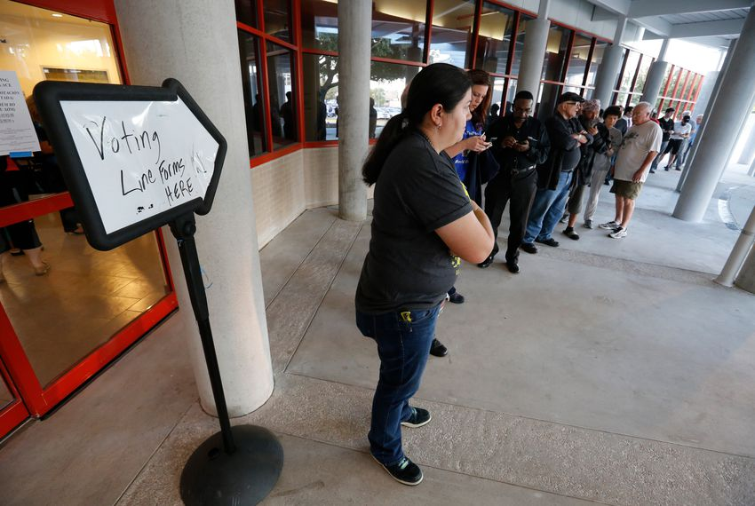 Voters line up at an early voting station in Houston on Oct. 24, 2016. Poll workers said the lines were much longer than normal for early voting.