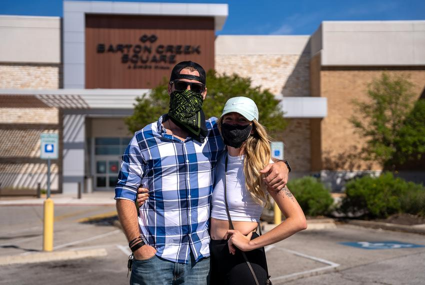John Whitton and Marina Oneill arrive early to shop at Barton Creek Square Mall on the day some Texas businesses began reo...