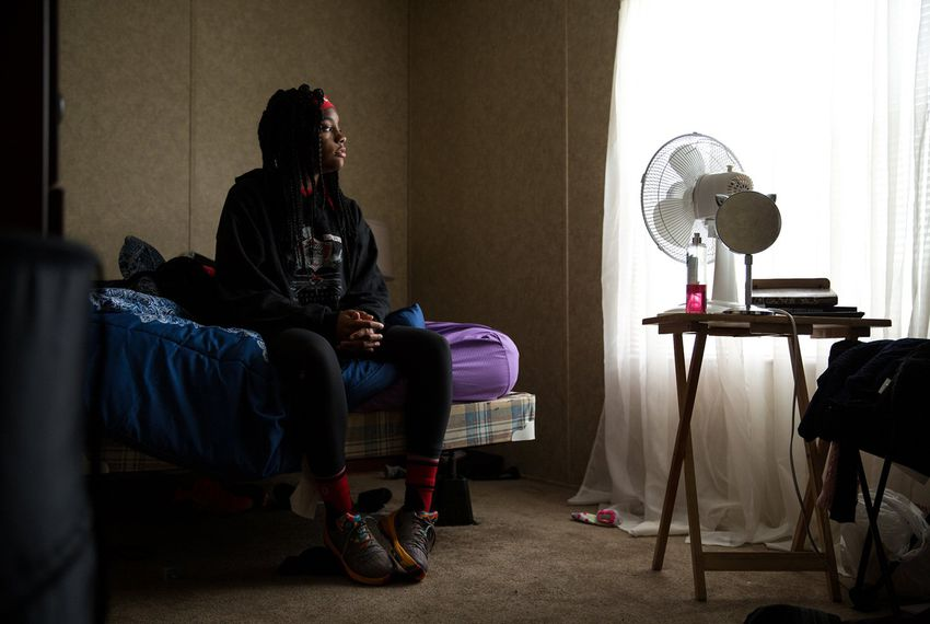 Darby Dugay, 17, sits in the bedroom of the FEMA mobile home where she and her family have lived since Hurricane Harvey flooded their home in Port Arthur.