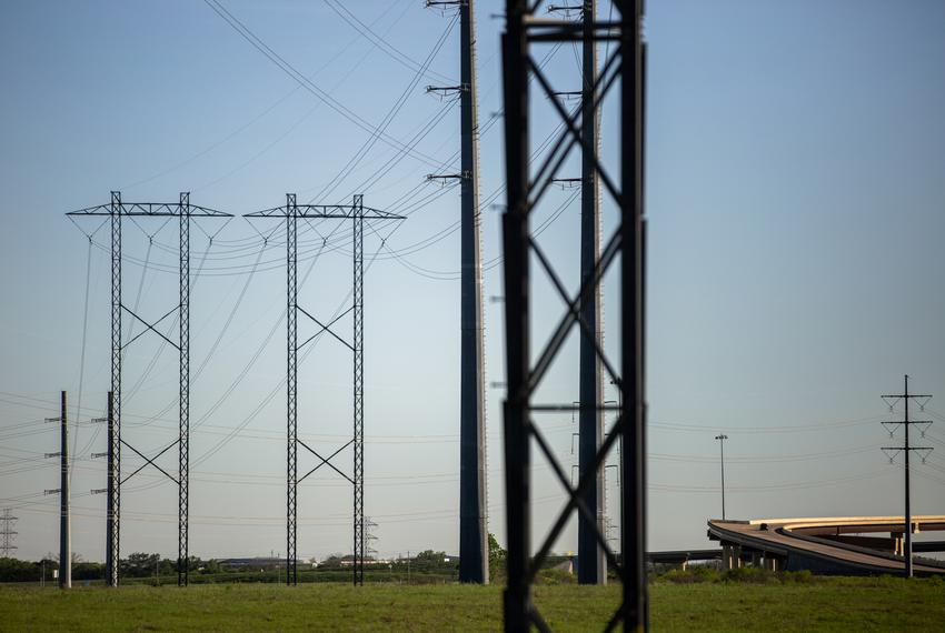 Electrical power lines near the Austin Energy/Sand Hill Energy Center in Del Valle on March 24, 2020.