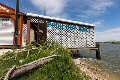 Poor Boy Bait shop in Port Lavaca sits just across the bay from the Formosa plant. Owner Dora Terry says plastic pollution has negatively impacted her business.