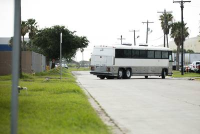 An immigration bus carrying migrants departs the U.S. Border Patrol Central Processing Center known as Ursula in McAllen on Thursday. The bus will drop-off the migrants at the McAllen Bus Station.