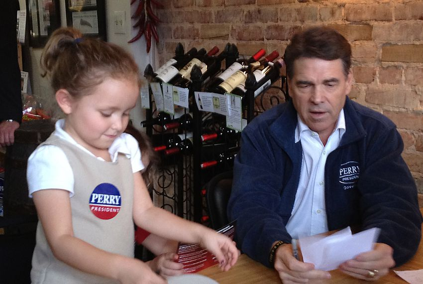 Gov. Rick Perry in Aiken, SC with Cam Mitchell, 5, at Ryan's Market & Deli - Jan. 11, 2012