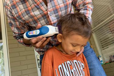 Rupal Shah shaved the sides of his son Nikhil's head after the 5-year-old's hair began to fall out as a result of chemotherapy treatments.